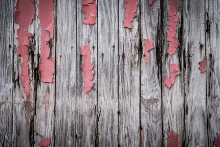 Old wooden boards with peeling paint