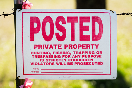 Private property sign on fence
