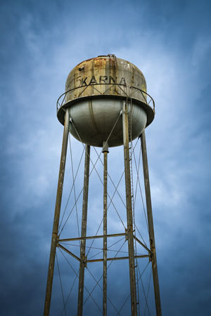 Rusty old town water tower