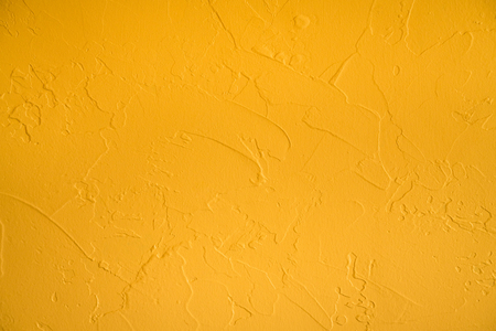Yellow plastered wall texture background