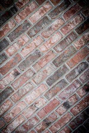 Diagonal grunge brick wall background