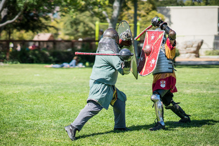 Medieval renaissance knights sword fighting Stock Photo - 104634524