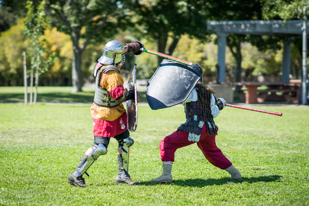 Renaissance medieval knights sword fighting Фото со стока