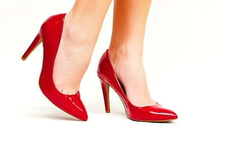 Sexy legs in red high heels isolated on white background photo