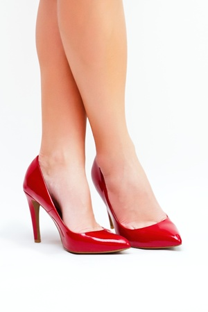 Sexy legs in red high heels isolated on white background Stock Photo - 12885578