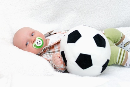 chap: little chap with a teddy soccer ball on white background