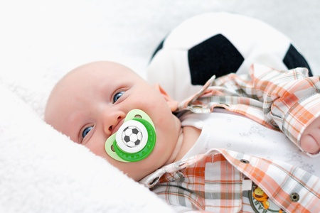 chap: little chap with a football pacifier