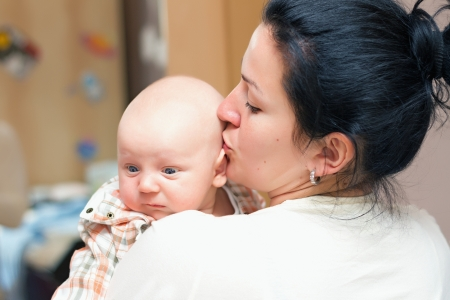 chap: Mother holding sweet little chap Stock Photo