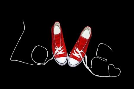 red sneakers for lovers of St  Valentine Reklamní fotografie
