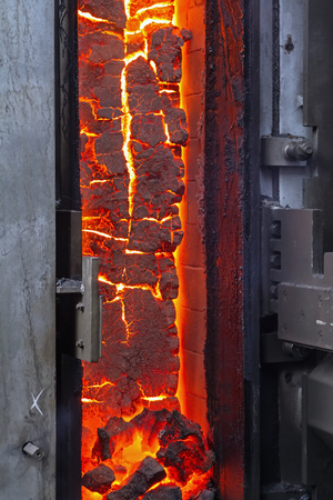 coking: View of the finished coke into the open door of the coke oven
