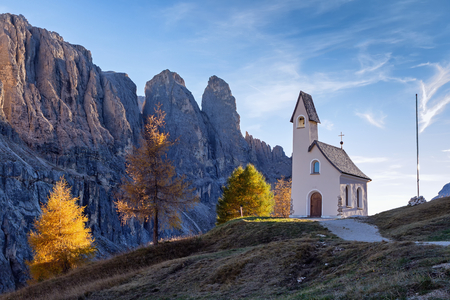 Mountain Chapel in Passo Gardena at sunset,Italy