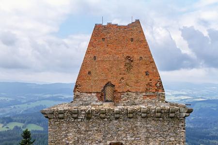 weatherworn: Sloping roof, built of burnt bricks