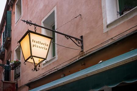 Light advertising on pizzeria in Italy