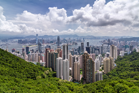 VICTORIA PEAK, HONG KONG - JULY 5, 2014: View from Victoria Peak to the business borough and the gulf in Hong Kong, July 5, 2014