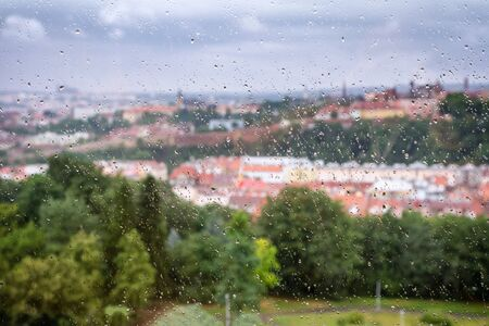 A crying city behind a window with rain drops Reklamní fotografie
