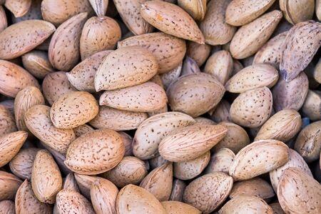 A pile of kernels of paddy bitter almonds Reklamní fotografie