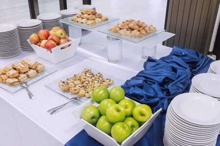 Sweet snacks accompanied by fruit