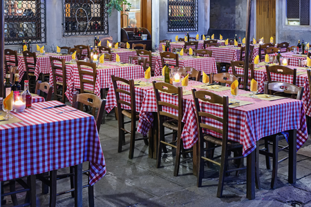 VENICE, ITALY - FEBRUARY 27, 2014: Outdoor seating of an Italian restaurant awaiting guests. February 27 evening in Italy Redakční