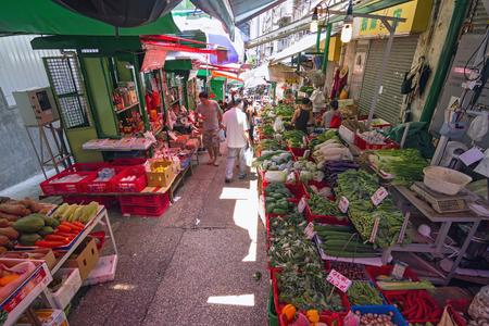 SOHO, HONG KONG - JULY 3, 2014: Street market between houses in SoHo, Hong Kong on July 3, 2014