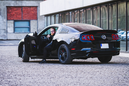OSTRAVA, CZECH REPUBLIC - JANUARY 6, 2018: Limited Edition Ford Mustang Roush and his driver in the industrial zone in Ostrava, January 2018 Redakční