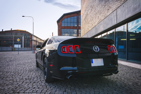 OSTRAVA, CZECH REPUBLIC - JANUARY 6, 2018: Limited Edition Ford Mustang Roush in black posing in the industrial zone in Ostrava, January 2018 Redakční