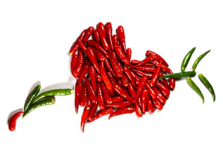 Symbol of love - Spicy hart isolated on white photo