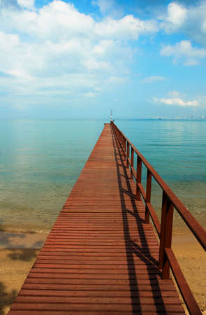 Wooden pier, bright turquoise sea, best place for tourism. Stock Photo - 6382745