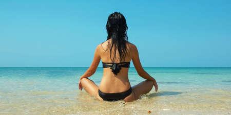 Beautiful women on the beach. Relaxing landscape.