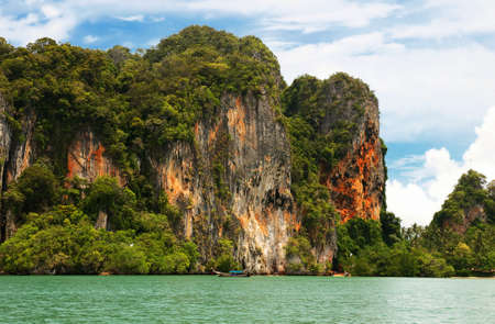 Hight cliffs on the tropical island. Exotic landscape.