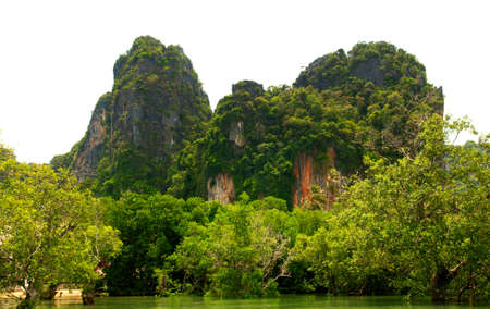 High cliffs on the tropical island. Exotic tropical landscape. photo