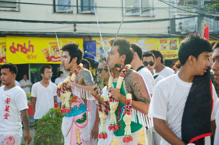 body piercing: Phuket Vegeterian Festival. Shocking asian tradition - body piercing. Editorial