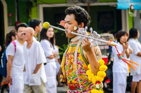 shocking: Phuket Vegeterian Festival. Shocking asian tradition - body piercing. Editorial