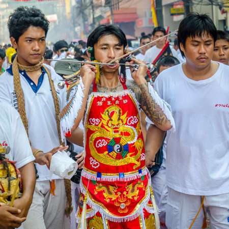 body piercing: Phuket Vegetarian Festival. Shocking asian tradition - body piercing.