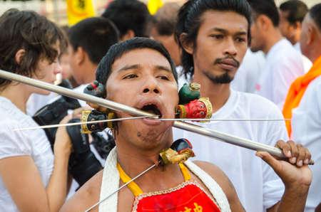 shocking: Phuket Vegetarian Festival. Shocking asian tradition - body piercing.