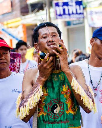 Phuket Vegetarian Festival. Shocking asian tradition - body piercing.