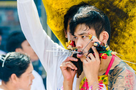 body piercing: Phuket Vegetarian Festival  Shocking asian tradition - body piercing  Editorial