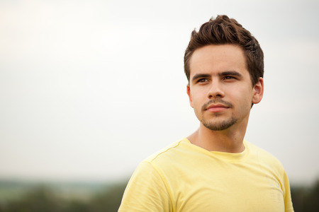 confidently: Portrait of a young man looking confidently ahead Stock Photo