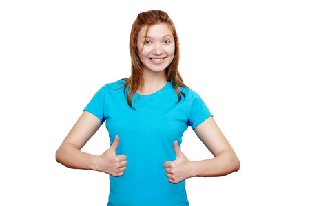 Happy female college student wearing blue t-shirt showing thumbs up with both hands