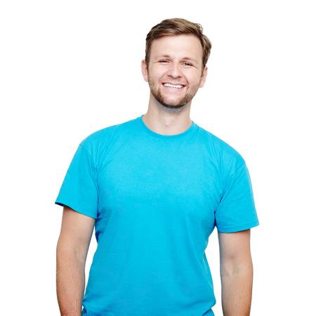 白い背景の上のスタジオで青い t シャツで笑みを浮かべて男の肖像 写真素材