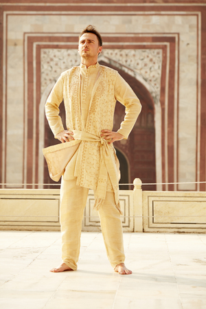 kurta: Confident caucasian young man wearing indian clothes in Taj Mahal, India