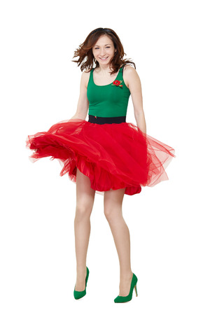 the skirt: Dancing girl wearing retro skirt isolated on white background. Beautiful brunette young woman jumping in high heels Stock Photo