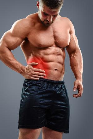 appendicitis: Muscular man having appendicitis attack. Acute abdomen pain. Glowing red area.