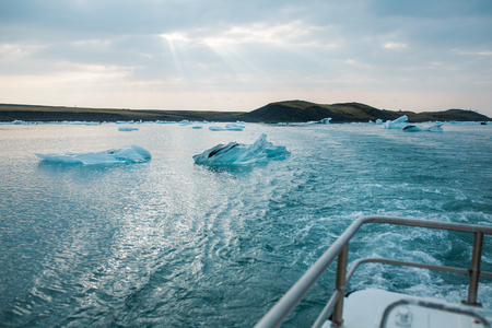 glaciers: Sailing between icebergs in Jokulsarlon Lagoon, Iceland. Amphibian tour among melting glaciers.