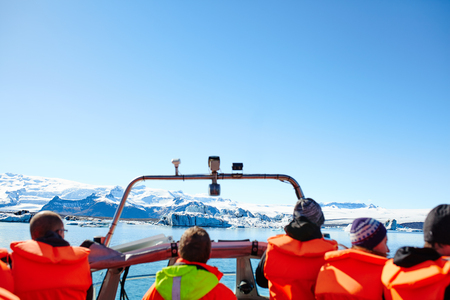 jokulsarlon: Sailing between icebergs in Jokulsarlon Lagoon, Iceland. Crowd on amphibian tour among melting glaciers. Stock Photo