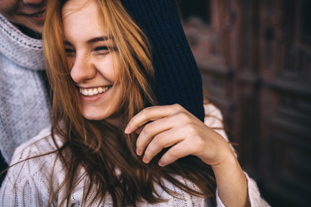 woman: Close up portrait of happy young hipster couple smiling together on autumn day