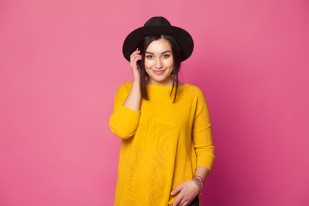 nude pretty girl: Trendy sexy young female wearing casual clothes posing over pink background Stock Photo