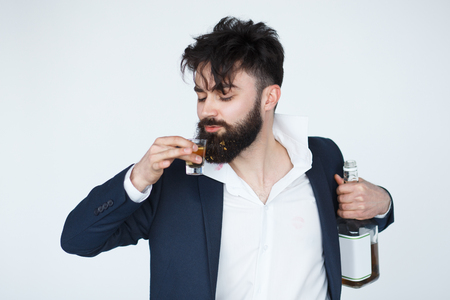 funny bearded man: Funny drunk man holding a whiskey bottle. Studio shot of bearded man with glass of alcohol isolated on white background.
