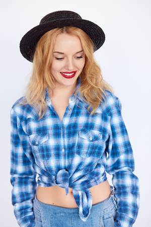 Vertical young woman with blond hair keeping eyes closed. Hipster girl dreaming