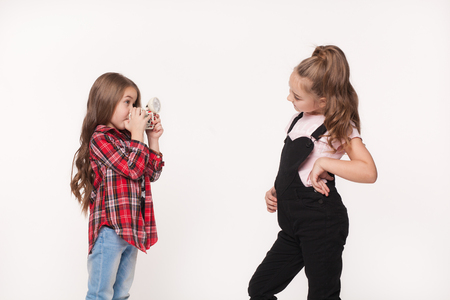 each: Two children girl taking a picture each other Stock Photo