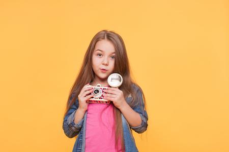 Cute adorable Girl Child with retro camera